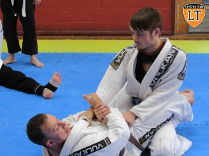 Teacher Diccon Lynes and blue belt Luke Hennessey demonstrating one of our sequences.